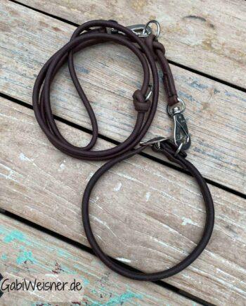 Hundehalsband und Leine rundgenäht. Dickes Nappaleder in dunkelbraun, mit Kern ca. 8 mm dick. Hundeleine mit Sprenger-Haken 1,8 m lang und 2-fach verstellbar.