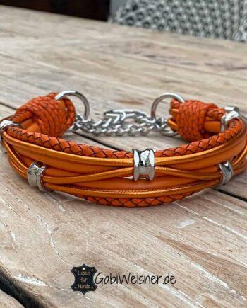 Luxus Hundehalsband mit Zugstopp. Leder Mix in Orange ca. 3,5 bis 4 cm breit. Dekoriert mit 5 Ohr-Tunnel aus Chirurgenstahl. Bestückt mit einer langen oder kurzen Zugstoppkette aus Edelstahl. Luxus für mittelgroße Hunde.