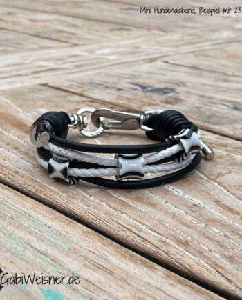 Mini-Halsband für ganz kleine Hunde. Leder Mix mit 3 Ohr-Tunnel in Schwarz / Weiß. Starker Halt mit kleinem SPRENGER Haken und Doppelwirbel, damit ist das Halsband einmal weiter verstellbar.